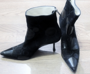 A great pair of Jimmy Choo Boots will add an urban feel to your pearls...
