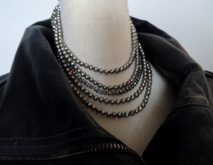 Wear some strands of pearls with your leather Moto jacket for Fall 2014